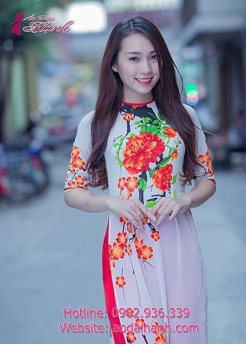 Áo dài trắng voan in hoa cam cổ tròn tay lỡ